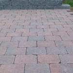 Mosaiken Tumlad marksten slät – rödsvart